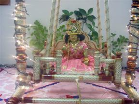 Statue of Krishna on a swing